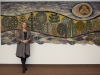 Danuta in front of her 1983 tapestry -
