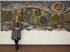 Danuta in front of her 1983 tapestry -